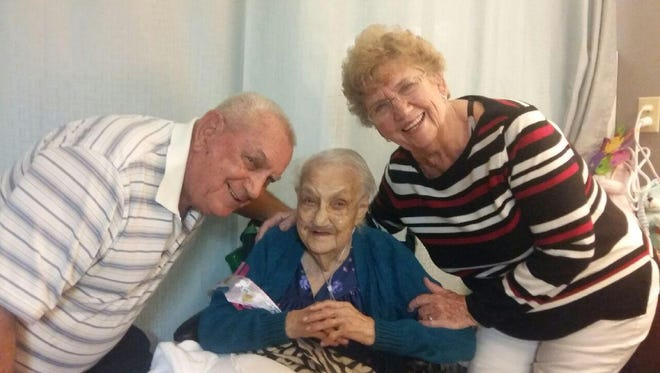 Mary Rivera, who lives at the Desert Springs Healthcare and Wellness Center poses with her son and daughter-in-law a week after she celebrated her 103rd birthday on Nov. 29, 2016.