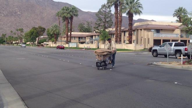 A man crosses Ramon Road outside of a crosswalk in Palm Springs.