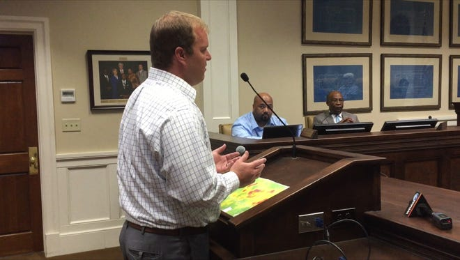 City engineer Lamar Rutland shows a map to City Council Monday with the locations where the city has received complaints about discolored water.