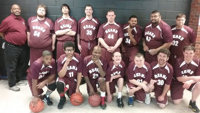 The Richland County Bears adult basketball team, wearing their new uniforms, play for a state championship Friday night against the Hamilton County Ballers in Bowling Green University's Stroh Center.