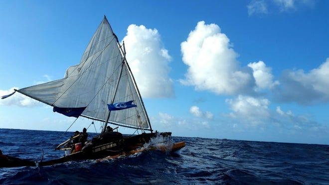 The Fanhigåyan Guåhan sets sail on the water.