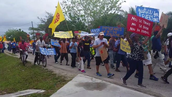 Workers march down the streets in Immokalee, Florida for International Workers' Day on Monday, May, 1, 2017.