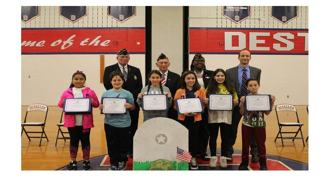 Winners in the American Legion contests with members of the American Legion and Gary Lubisco Jr. at faber School in Dunellen.