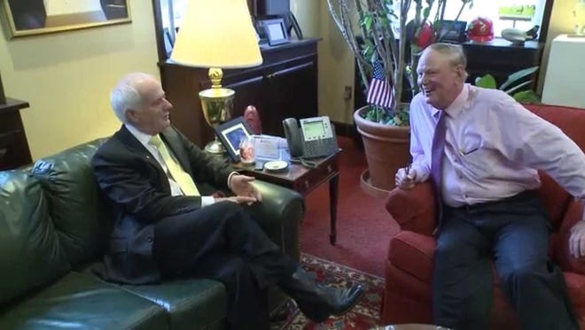 A big U of L donor has canceled his commitment to U of L due to 'extreme dissatisfaction with current leadership.' Pictured here in 2014 is Bob Huges, chairman of the university's board, and former President James Ramsey.