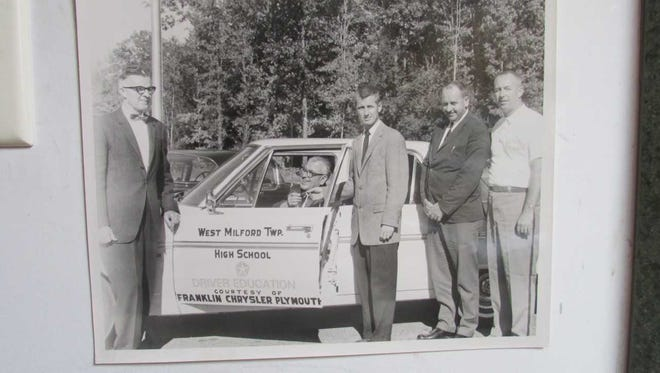 In 1965, students at West Milford High School, through courtesy of Franklin Chrysler Plymouth, learned to drive in this car. From left are Reginold Montrose and Russell Kelsch of the dealership, driver's education teacher Walter Benson, High School Acting Principal William (Bill) McCormick and Director of Athletics Paul Ryan.