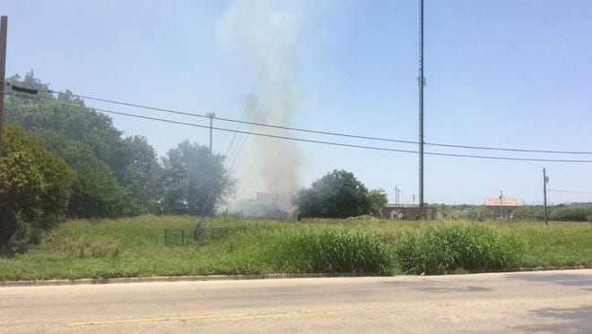 What appears to be a grass fire burning near Bryant Boulevard and 14th Street on Wednesday, June 14.