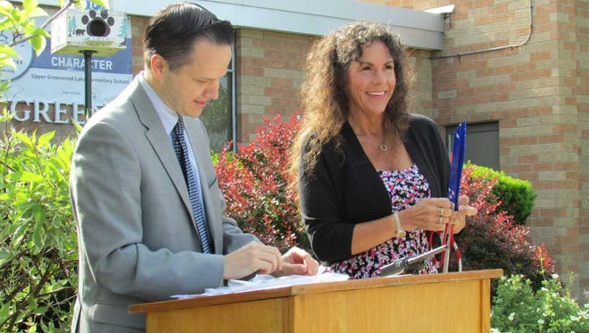 Upper Greenwood Lake School Principal Dr. Greg Matlosz and West Milford Mayor Bettina Bieri speak at the school's 50th birthday celebration.