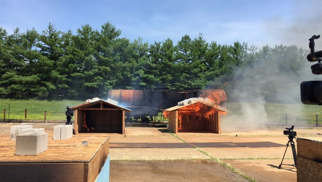 M. Fire Suppression Inc. showed how its products can stop fires from spreading. On the left is a model house treated with the chemical spray, while the house on the right was not treated with anything.