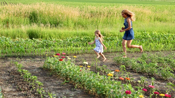 Five acres of land surrounding their home provide Casey Lawrence and daughter Lana with plenty of room to run.