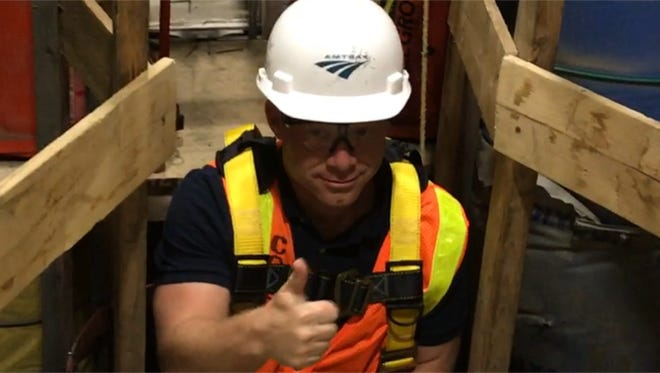 Rep. Josh Gottheimer climbing 90 feet down to an Amtrak connector leading to the future Gateway tunnel.