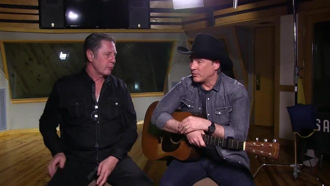 Clint Black, right, talks to Bart Herbison about songwriting.