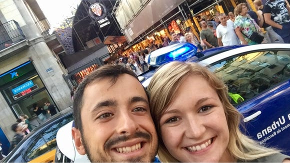 Víctor Naranjo, of Barcelona, Spain, and Argus Leader reporter Danielle Ferguson pose for a picture in front of La Boqueria one week before an ISIS-claimed white van killed 13 and injured more than 100.