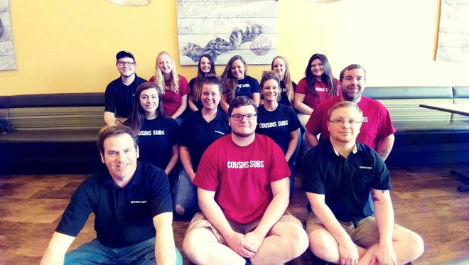 The staff of the Cousins Subs at 4530 Calumet Ave. in Manitowoc.