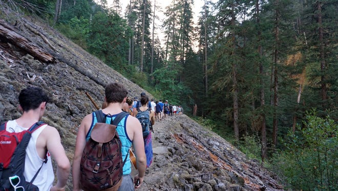 Around 150 hikers head away from the Eagle Creek Fire last Saturday on Eagle Creek Trail.