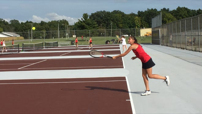 Pleasant No. 1 girls tennis player Arielle Wenig delivers a serve Tuesday afternoon at Buckeye Valley.