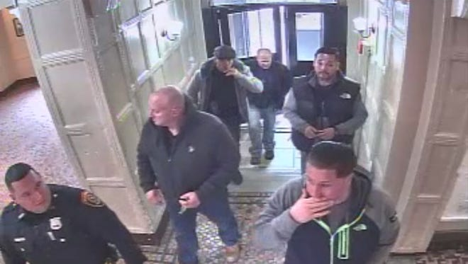 In this still image taken from surveillance footage, a group of Hackensack officers enter an apartment building on Prospect street in December  2016.