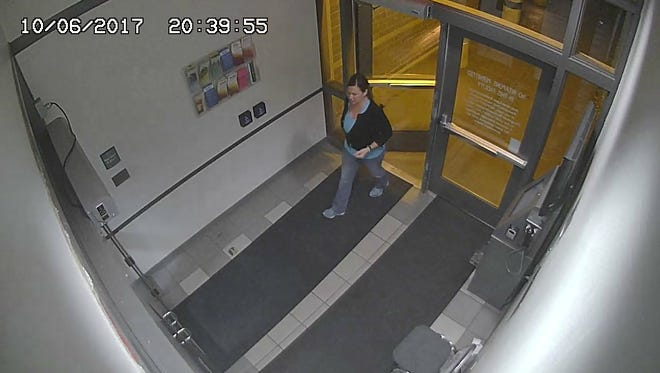 A surveillance photo on Oct. 6, 2017, from Flagstaff police shows Cathryn Gorospe, who was last seen bailing out Charlie Malzahn.