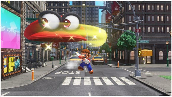 Mario tosses Cappy in 'Super Mario Odyssey.'
