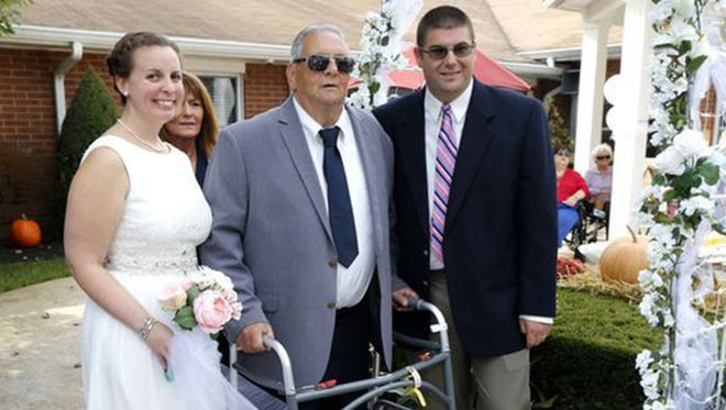 After the ceremony (left to right): Ellen Tyndell, Kim DiPaolo, Tommy DiPaolo and Tom DiPaolo pose for photos.