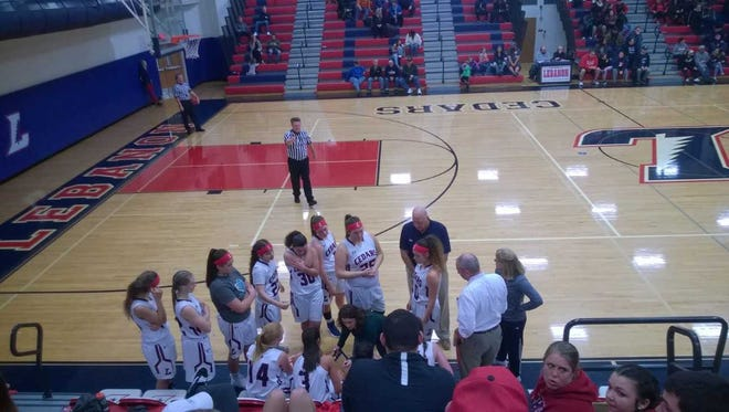 Lebanon head coach Jaime Walborn instructs her players during a timeout on Wednesday, Jan. 10., at Lebanon High School. The Cedars lost to rival Cedar Crest, 48-21..