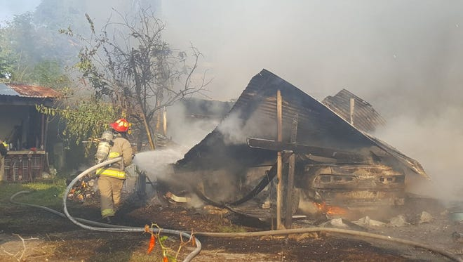 Guam Fire Department doused a fire that consumed a wood-and-tin extension to a concrete home in Mangilao on Tuesday, Jan. 16, 2018. Eight occupants evacuated and no injuries were reported, GFD said.