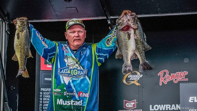 Tim Frederick of Leesburg jumped into the FLW Tour lead Saturday with a 23-pound bag limit and won it all Sunday with 85 total pounds of bass in four days to take home $100,200 in his first FLW Tour victory.