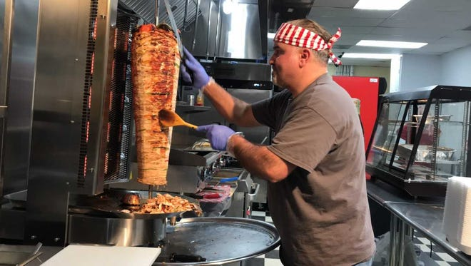 Chef Nader Al-Harash tends to the chicken at Mr. Shawarma on Ninth Avenue on Monday, Jan. 29, 2018.