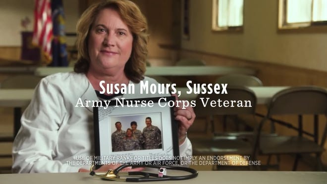 Attorney Michael O. Marquette, whose image is on the far left of the photo held by Susan Mours of Sussex, objects to being in a VoteVets.org ad supporting Democratic U.S. Sen. Tammy Baldwin.