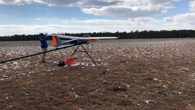 "An unmanned drone is prepared to take off March 8 at Woodbine Municipal Airport in South Jersey carrying a ""femtocell"" that Verizon can fly into an area that loses cellular coverage during a natural or other emergency."