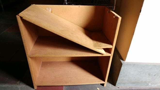 """This broken shelf was left as a """"donation"""" for Mary's Place."""