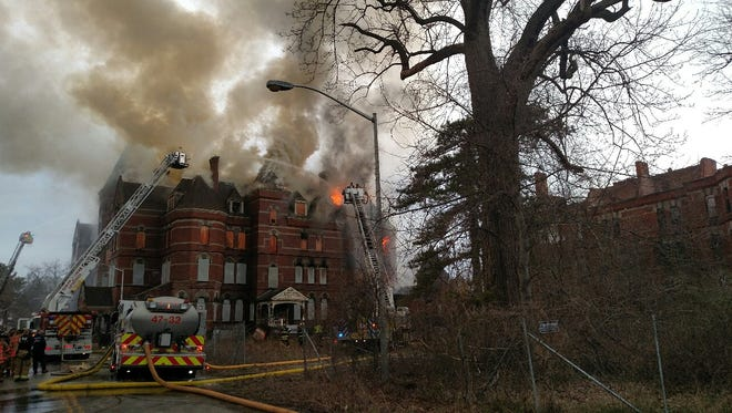 Firefighters on Friday, April 27, battle a blaze at the former Hudson River Psychiatric Center in the Town of Poughkeepsie.