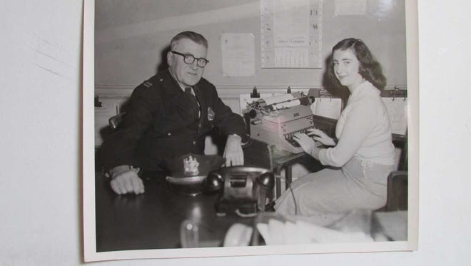 Ringwood Police Captain Willman H. Taft and Paterson Evening News reporter Ann Genader are seen in the 1950s working on a report at Ringwood Police Headquarters.