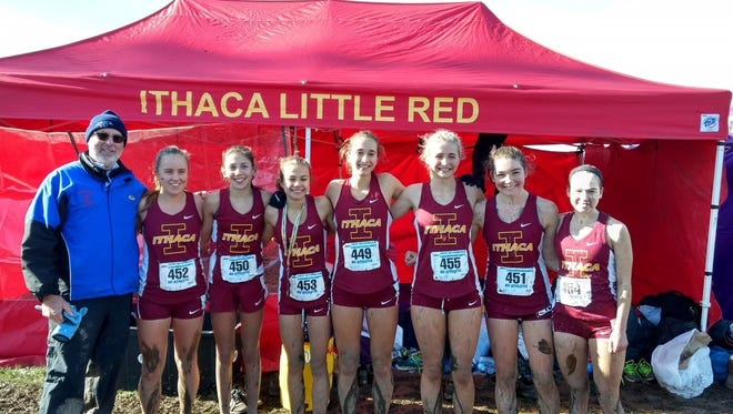 Rich Bernstein with the Ithaca girls cross country team at the 2017 New York State Public High School Athletic Association championship meet at Wayne High School in November.