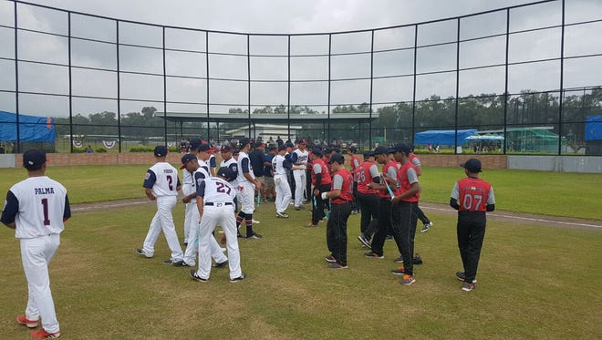 The Guam Senior League All-Stars meet the India Seniors at the start of their game at the Asia Pacific Regional Championships June 30 in the Philippines. Guam won 23-0.