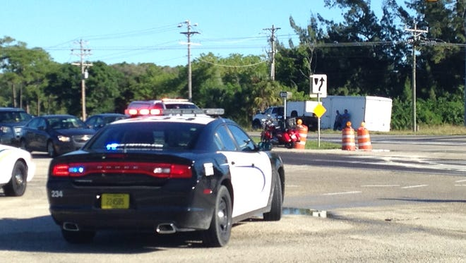 LCSO and Cape Police direct traffic at Del Prado and US 41 after a truck dumped a load of honey at the intersection.
