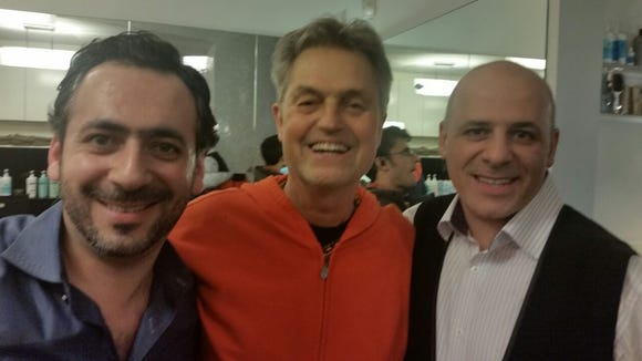 Nuriel Abramov, left, posed with the director of 'Ricki and The Flash,' Jonathan Demme, center. Scenes were filmed in Abramov's Rye salon, Numi & Company