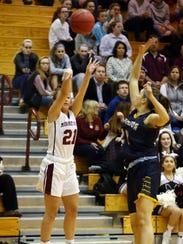 Morristown's Nicole Ferrara goes for a jump shot during