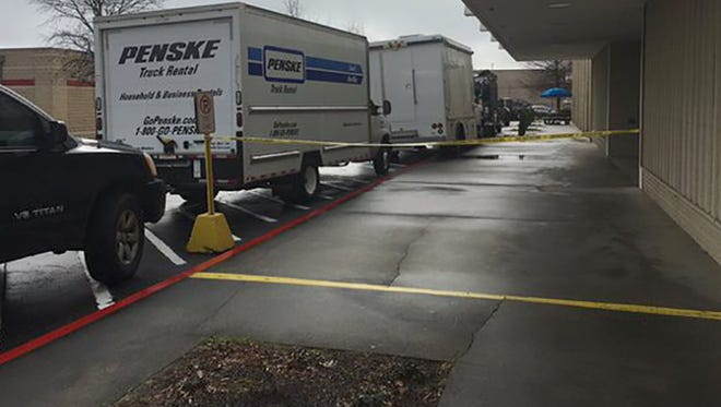 Crime scene tape is seen at the Jackson Medical Mall after the FBI serves a search warrant.