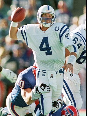 Colts quarterback Jim Harbaugh (4) throws from in the grasp of Buffalo defensive end Phil Hansen in 2nd quarter action of the Colts 37-35 loss at Rich Stadium Sunday, September 21, 1997.   (STAFF PHOTO/PAUL SANCYA)