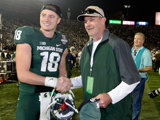 Kirk Gibson, right, poses with Michigan State quarterback