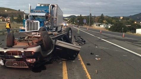 Oregon State Police and emergency personnel responded to a collision involving a semi-truck and a passenger vehicle at the Highway 42 interchange with Interstate 5 on Sunday.