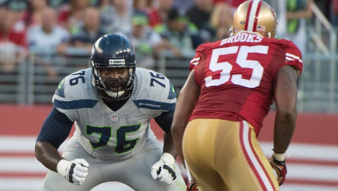 In this file photo, October 22, 2015; Santa Clara, CA, USA; Seattle Seahawks tackle Russell Okung (76) blocks San Francisco 49ers outside linebacker Ahmad Brooks (55) during the first quarter at Levi's Stadium. The Seahawks defeated the 49ers 20-3. Mandatory Credit: Kyle Terada-USA TODAY Sports