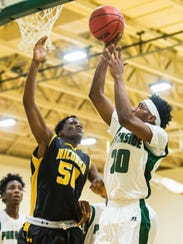 Parkside guard Gary Briddell (20) takes a shot against