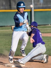 Redwood's Davis Beavers gets to first on a wild throw
