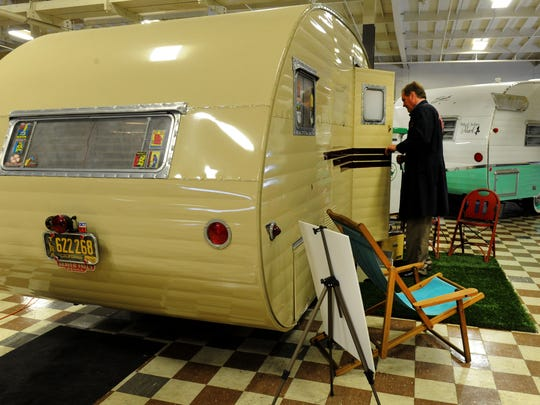 David Neel, director of the Murphy Auto Museum in Oxnard, steps inside the Hanson Love Bug Trailer on display for the 2017 Vintage Trailer Show.