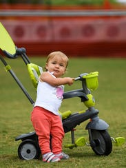 Skye Bulbe, 1, warming up her trike and ready to go