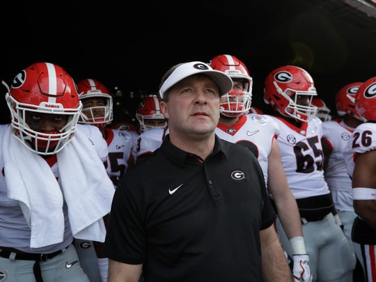 Kirby Smart and Georgia players prepare to run on the field ahead of the 2018 Rose Bowl vs. Oklahoma.