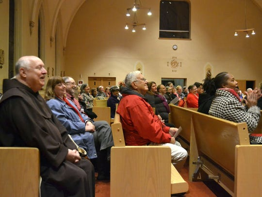 Attendees listen to the Rev. L.C. Green's sermon during