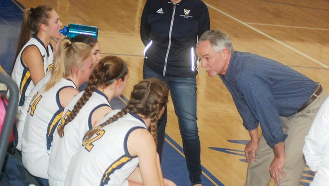 Eastern Christian coach Barry Veenstra talking to his team during a timeout in the NJIC tournament final.