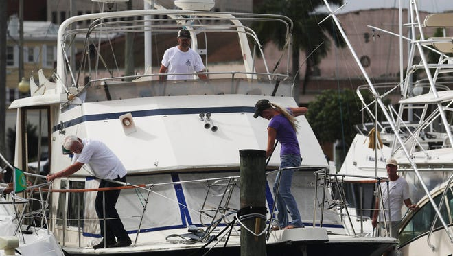 Boaters in Fort Myers, Fla., just south of Tampa, prepare for Hurricane Irma.